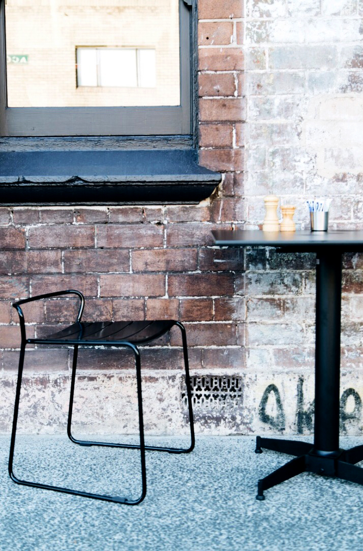 Exterior shot of Tucker cafe in Sydney featuriung NOROCK's Parkway self-stabilising table base