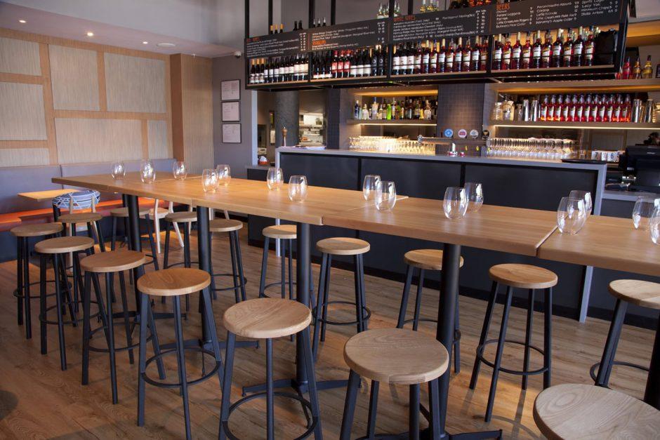 Spritz Spizzicheria - indoor bar featuring NOROCK Parkway self-stabilising bar height table bases