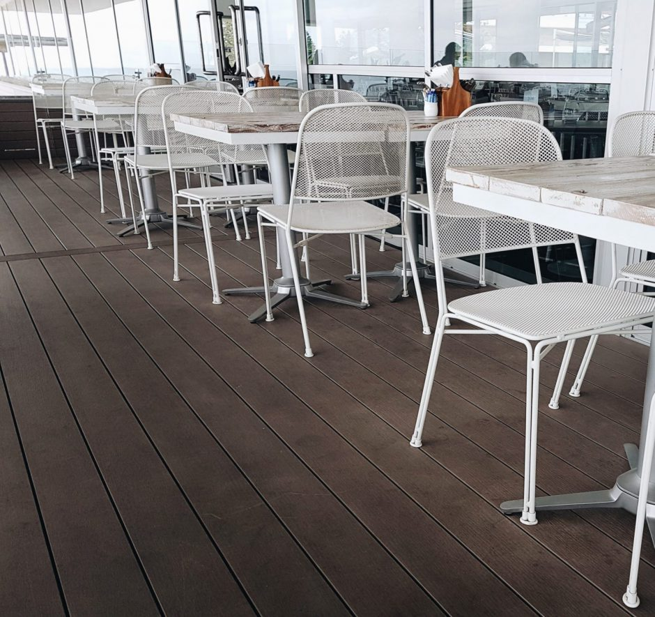 Hamptons City Beach on the outdoor balcony featuring NOROCK Esplanade self-stabilising table base
